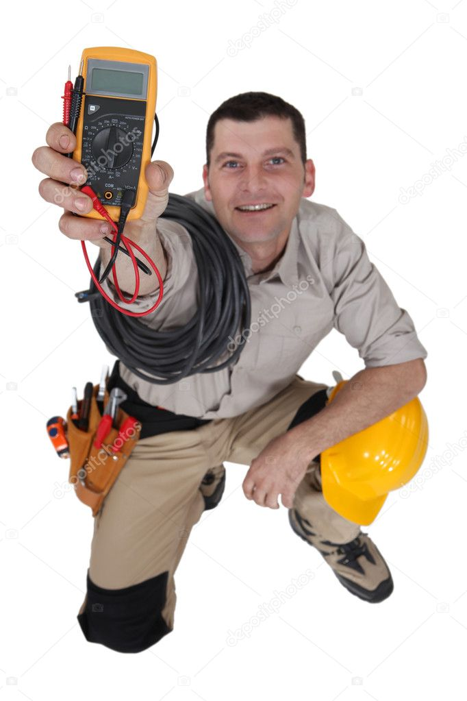 Electrician holding a measurement tool  Stock Photo #8651278