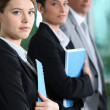 Young businesswoman with colleagues — Stock Photo #8660018