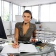 A receptionist busy at work — Stock Photo
