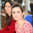 Brunette in office with colleagues — Stock fotografie