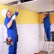 Electricians in room under construction — Stock Photo #8663838