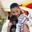 Little girl holding dog - 