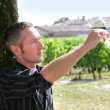 Wine maker tasting the wine from his property — Stock Photo