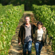 Couple walking in their vineyard — Stock Photo