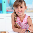 Little girl smiling in classroom — Stock Photo