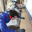 Stock Photo: Laborers working on industrial machines