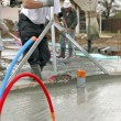 Workers pouring a cement foundation — Stock Photo #8666881