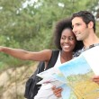 Couple reading map outdoors — Stock Photo