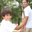 Man out for a walk with his young son — Stock Photo
