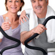 Stock Photo: Senior couple in the gym