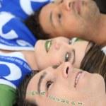 Italian football fans with Forza Azzurri facepaint — Stock Photo