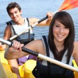 Couple in kayak — Stockfoto