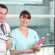 Stock Photo: Smiling doctor and practical nurse