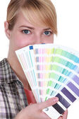 Woman choosing color of paint — Stock Photo