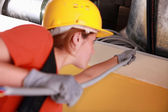 Young female electrician — Stock Photo