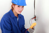 Woman using a multimeter — Stock Photo