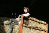 Woman sat on hay bales — Stock Photo