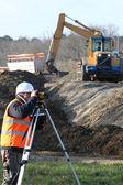 A land surveyor using an altometer — Stock Photo