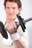 Man lifting dumbbell — Стоковое фото