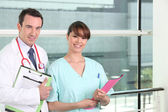 Smiling doctor and practical nurse — Stock Photo