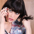 Young woman talking on the phone — Stock Photo #8671058