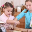 Two little girls baking — Stock Photo #8671401