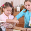 Stock Photo: Two little girls baking