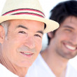 Father and son enjoying each other's company on a sunny summer's — Stock Photo #8671957