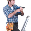 Tradesmusing electric screwdriver — Stock Photo #8674239