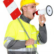 Stock Photo: Laborer screaming in bullhorn