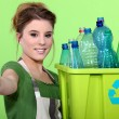 Stock Photo: Womholding crate of plastic bottles