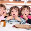 Little kids eating pancakes — Stock Photo #8675607