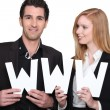 Stock Photo: Business people are holding www