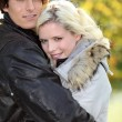 Couple wearing winter coats — Stock Photo