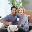 Couple and dog move in to new home — Stock Photo