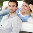 Stock Photo: Young couple on sofa