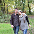 Stock Photo: Couple taking autumnal stroll