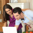 Couple looking for a recipe on the internet — Stock Photo