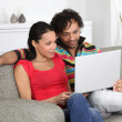 Couple looking at pictures on their laptop — Stock Photo #8678691