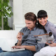 Couple on the living-room couch — Stock Photo