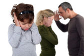 Daughter stood with arguing parents — Stock Photo