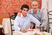 Two generations sitting in a restaurant — Stock Photo