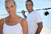 Woman going fishing with her husband — Stock Photo
