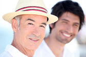 Father and son enjoying each other's company on a sunny summer's — Stock Photo