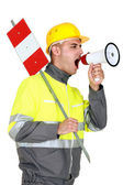 Laborer screaming in a bullhorn — Stock Photo