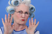 Old lady wearing hair rollers — Stock Photo