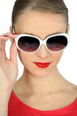Pretty blonde showing off with sunglasses — Stock Photo