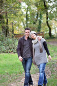 Couple taking an autumnal stroll — Stock Photo