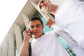 Two teenage boys near a building — Stock Photo