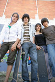 Teenagers with skateboards — Stock Photo